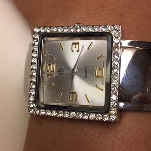 Cuffed silver watch with diamond accents